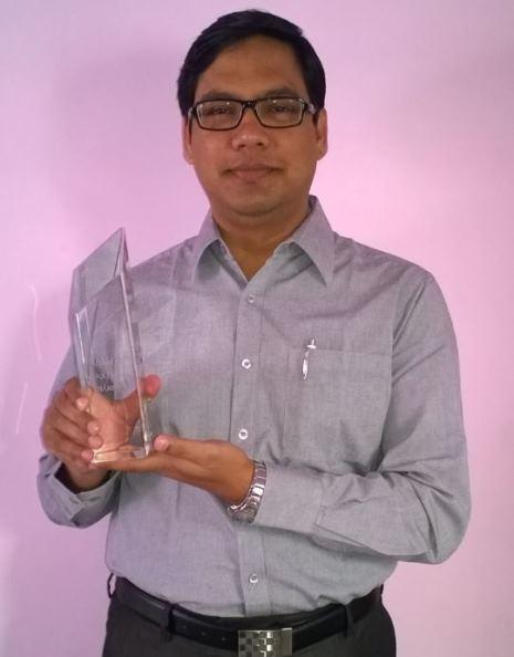 Arshad Ali proudly displaying his Champion Award,