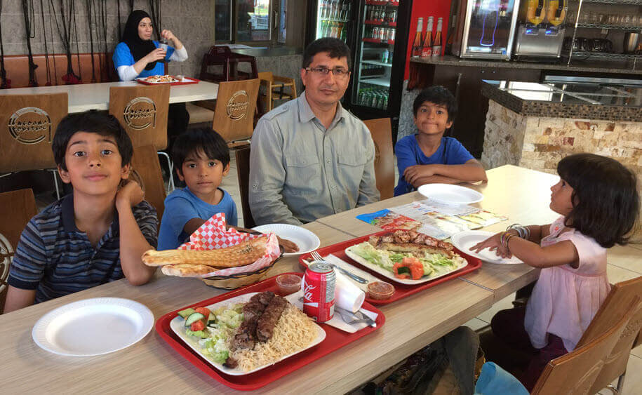 Muhammad Ahmad with his family enjoying their favo